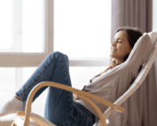 woman sitting in chair with eyes closed relaxing