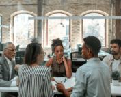 People sat around table talking