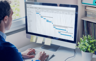 man doing project plan with gantt chart