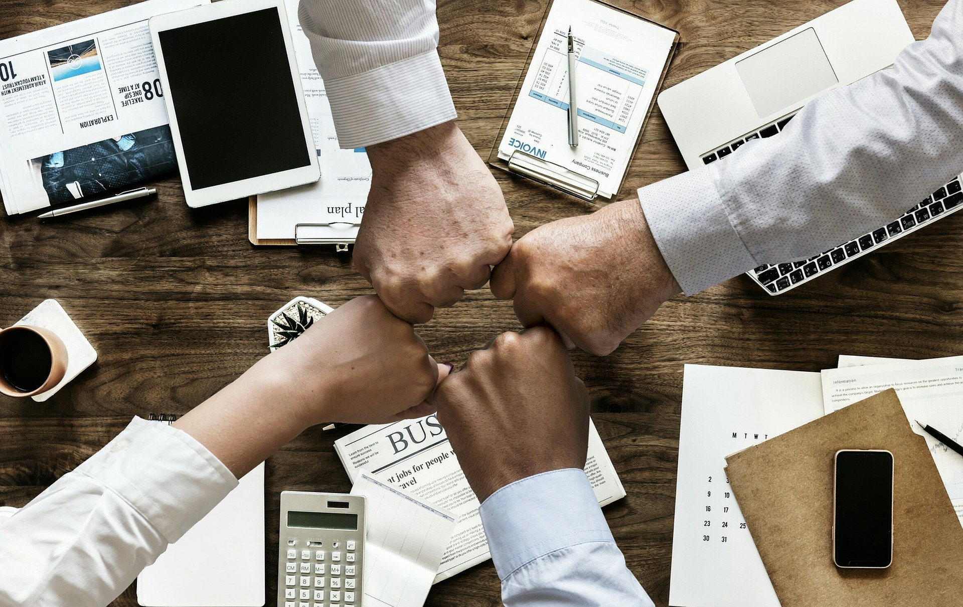 team of people joining hands
